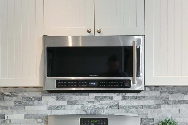 a modern stainless steal stove top and microwave